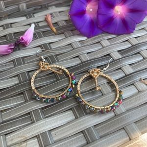 Gold circle earrings with key detail